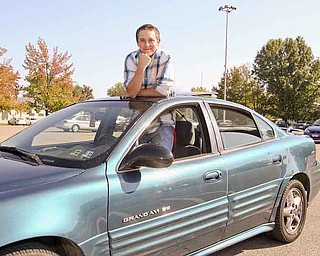 Charles Flesch, a student at Austintown Fitch High School, pokes out of the sunroof of his car. After attending 17 schools in four states, he's confident he's found a place he can call home.
