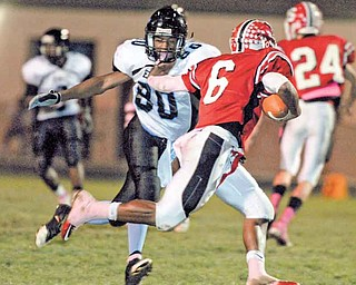 Youngstown East defender #80 (name not on roster) goes for the sack of Struthers quarterback #6 Tommy Kimbrough.