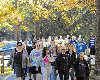A group nears the finish line at the annual Alzheimer's Walk at Boardman Township Park. More than 500 people participated in the event Saturday, including those with the disease and their family members, friends and caregivers.