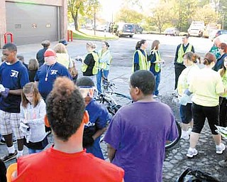 Several volunteers gather outside Campbell City Hall on Tenney Avenue to prepare to spend a portion of Saturday cleaning up a section of a major city thoroughfare. They cleared trash and cut grass on Wilson Avenue at Coitsville Road. The Campbell Pride Project will have a meeting at 6 p.m. Wednesday at the community center in Roosevelt Park for people interested in starting a block-watch program.