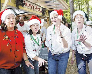 Visitors to the Shaker Woods Chistmas In the Woods Festival on Sunday were treated to the sounds of Reckless, a vocal group based out of Pittsburgh. The singers donned Santa hats while they performed. From left, they are Nancie Jaicks, Sharon Peters, Peggy Sue Henshey and Nancy Conway.