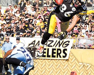 Pittsburgh Steelers receiver Hines Ward (86) heads to the end zone over Tennessee Titans safety Michael Griffin, scoring a touchdown during the third quarter of an NFL football game in Pittsburgh, Sunday, Oct. 9, 2011. (AP Photo/Gene J. Puskar)
