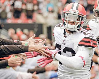 Cleveland Browns cornerback Joe Haden slaps hands with fans as he comes onto the field to face the Tennessee Titans in an NFL football game on Sunday, Oct. 2, 2011, in Cleveland.  The Titans won the game 31-13. (AP Photo/Amy Sancetta)
