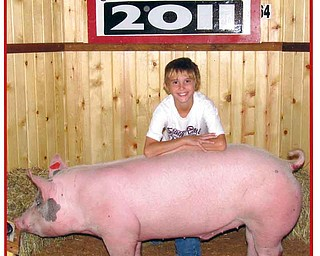 Cole poses with his 4-H pig Big Ben at the 2011 Canfield Fair.