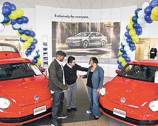 Jaime Garayua, general manager of Stadium Volkswagen in Boardman, presented the keys to two 2012 Volkswagen Beetles to Kimberly Winfrey and Toles. The cars were purchased by Oprah Winfrey, and the taxes and fees were paid by Volkswagen.