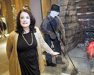Martha Pallante, Youngstown State University history department chairwoman, tours an exhibit at the Youngstown Historical Center of Industry & Labor during a fundraiser for the museum Thursday.