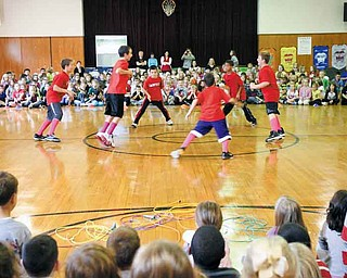 Fourth-grade students at C.H. Campbell dance at the conclusion of the school's Jump Rope For Heart kick-off fundraising assembly. The school has raised $87,000 for the American Heart Association since 1997.