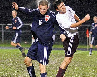 Fitch's Kyle Kosco (18) and Boardman's Matt Horvatich (23) head the ball during a soccer rivalry Thursday in Boardman. The game was called in the first-half due to lightning and will be rescheduled.