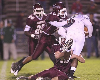 ROBERT  K.  YOSAY  | THE VINDICATOR --..Stopped dead Glenoak  #7 Dashawn Hall is corraled and stopped dead in his tracks by Boardman #43 Doug Brandt and #19 Leslie McIntosh as #28 Ivan Adu Poka (ok) - during first quarter action as .Glen Oak vs Boardman at Boardman High School -..--30-..(AP Photo/The Vindicator, Robert K. Yosay)