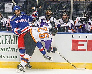 Des Moines' Kevin Irwin, left, is checked at the boards by Youngstown Phantoms' Alex Gacek (26) during Friday's home opener at the Covelli Centre. The Phantoms won 4-2.
