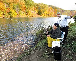 Greg Cappitte, right, and his father, Norm Cappitte, spend Friday afternoon fishing at Lake Glacier in Mill Creek MetroParks. The leaves will reach peak color this weekend, according to The Ohio Department of Natural Resources.