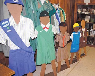 Girl Scout uniforms from the past and present are on display in the museum at the former Lake to River Girl Scout Council office on Warren Avenue in Niles.