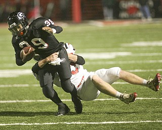 ROBERT K. YOSAY | THE VINDICATOR..Girards #39  Cameren Harden  drags LaBrae player  #5 5 Tyler Carter as he rushes for a first down during second quarter action . ...-30