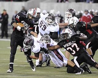 McLKinley running back #34 Jarrod Smith is tackled by Boardman linebacker #56 Justin Babos.
