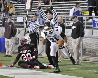 Boardman running back #21 Devin Campbell celebrates after scoring a touching. McKinley defensive back #20 Chad Fite.