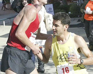 William D. Lewis|The Vindicator Third place runner Andrew Carnes, left, get  congrat form winner Aziz Atmani at end of race.
