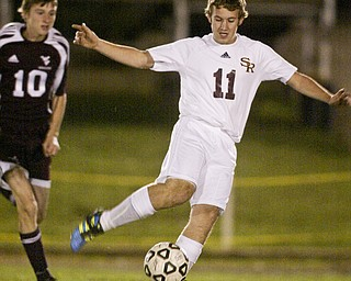 William D Lewis The Vindicator  South Range's  #11 Joel Skidmore keeps the ball from Waterloo'sJeremy Floyd during Tuesday action at SR.