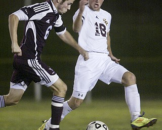 William D Lewis The Vindicator  South Range's  #18Andy Lacefield  keeps the ball from Waterloo's Jake Podnar during Tuesday action at SR.