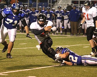 FOOTBALL - (2) Jordan Italiano of Canfield tries to get away from (22) Jerry Lawman Friday night in Poland. - Special to The Vindicator/Nick Mays