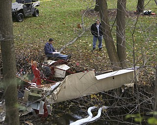 ROBERT K. YOSAY | THE VINDICATOR || Ronald Catchpole, 54, of King Graves Road, had flown the plane for a couple years with no problems, according to his friend and witness to the crash, Jeff Jardine.