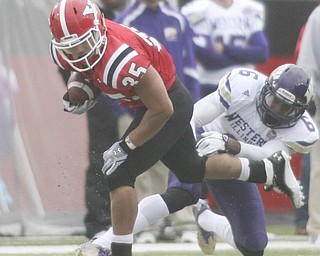 ROBERT K. YOSAY | THE VINDICATOR..#35  YSU  Jamaine Cook breaks thru defender James Kieron as he breaks down the sideline during second quarter action..YSU vs Western Illinois - homecoming at YSU and a win 56-14 ......-30