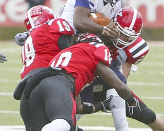 ROBERT K. YOSAY | THE VINDICATOR...No where to go as #20 Larry Patterson WIU  is surrounded byYSU -   19 Daniel Stewart - 10 Josh Lee and   24 Scott Sentner -- YSU vs Western Illinois - homecoming at YSU and a win 56-14 ......-30
