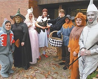 "Proponents of pet adoption staged a Halloween event Monday, dressed as the cast of ""The Wizard of Oz,"" looking for a missing Toto.  They found him at the Mahoning County Dog Pound. Participants were, from left, Nicole Ramson of Packer Thomas as a flying monkey, Carol Bukovac of Animal Charity as the Wicked Witch of the West, Diane Less of Angels for Animals as Glinda the Good Witch, Gary Pilcher of Animal Charity as Dorothy, Mahoning County Dog Warden Matt Ditchey, Tyneisha Phillips as the Scarecrow, Kate McDermott of Angels as the Cowardly Lion and Christine Popovich of the Daily Legal News as the Tin Man."