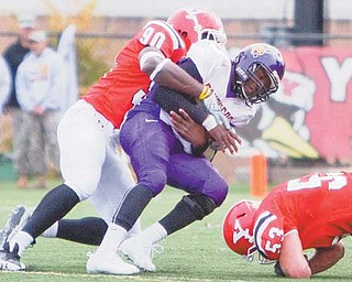 Obinna Ekweremuba (90) tackles Northern Iowa quarterback Tirrell Rennie during last season's game at Stambaugh Stadium. Rennie left last week's game with injuries and his status is questionable for Saturday's game against the Penguins.