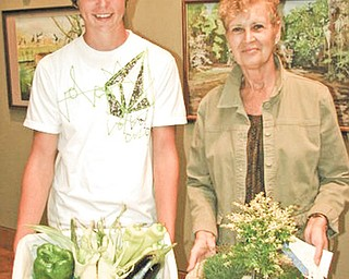 Robert Voland and Dianna Mullins show off their respective youth and adult Best of Show winning entries in the Men's Garden Club of Youngstown's 47th Horticultural Show, which took place recently at Fellows Riverside Gardens.
