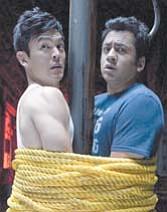 "John Cho (Harold) and Kal Penn (Kumar) star in ""A Very Harold & Kumar 3D Christmas."""