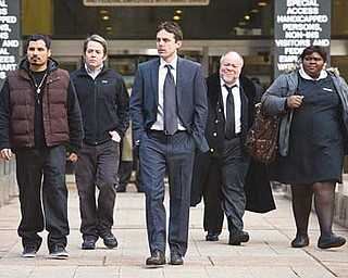 "From left, Michael Peña, Matthew Broderick, Casey Affleck, Stephen McKinley Henderson and Gabourey Sidibe star in ""Tower Heist,"" an action comedy about working stiffs who seek revenge on the Wall Street swindler who stiffed them."