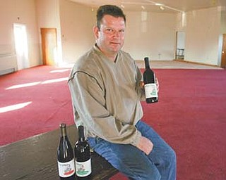 Ron Birchak talks about one of the wines Halliday's Winery will debut during a Celebrate the Harvest wine-tasting event from 4 to 8 tonight at Olde Dutch Mill Golf Course in Lake Milton.