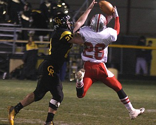 FOOTBALL - (21) Justin Baker of Crestview breaks up a pass as (28) DJ Kleppel can't haul it in during thier game Friday night in Crestview. - Special to The Vindicator/Nick Mays