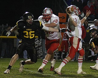 FOOTBALL - (36) of Crestview tries to sack (13) Alex Zander as (58) Austin Lane tries to make a block during thier game Friday night in Crestview. - Special to The Vindicator/Nick Mays