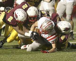 ROBERT  K.  YOSAY  | THE VINDICATOR --..DOWN -  Canal Fultons #32  Ronnie Beers is  brought down hard by  Mooneys #2  Kareem Ellis -310  Justus Ellis-moore  and #38  C J Bias  during second Quarter action ..Cardinal Mooney Cardinals vs Canal Fulton Northwest Indians at Stambaugh Stadium in the Regional Quarterfinals .--30-..(AP Photo/The Vindicator, Robert K. Yosay)