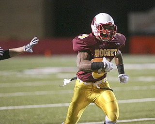 ROBERT  K.  YOSAY  | THE VINDICATOR --..Romping for another touchdown #3 Roosevelt Griffin  takes one in for a touchdown during second quarter action ..Cardinal Mooney Cardinals vs Canal Fulton Northwest Indians at Stambaugh Stadium in the Regional Quarterfinals .--30-..(AP Photo/The Vindicator, Robert K. Yosay)