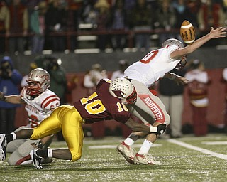 ROBERT  K.  YOSAY  | THE VINDICATOR --..Mooneys #10  Justus Ellis-Moore Takes down Canal Fultons QB #10  Nick Riley  causing a fumble as Mooney went on to defeat Canal Fulton - ..Cardinal Mooney Cardinals vs Canal Fulton Northwest Indians at Stambaugh Stadium in the Regional Quarterfinals .--30-..(AP Photo/The Vindicator, Robert K. Yosay)