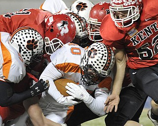 Howland fullback #40 Brandon Miller is tackled by a pack of Kent Roosevelt Roughriders.