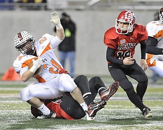 Howland receiver #24 Tyler Drass is tackled by Roosevelt's #51 Robert Hayden.