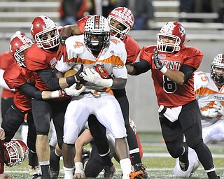 Howland running back #4 DeVeon Smith is tackled by a pack of Kent Roosevelt Roughriders.