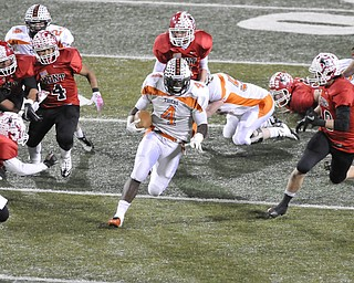 Howland running back #4 DeVon Smith running back cuts back accross the field for extra yards.