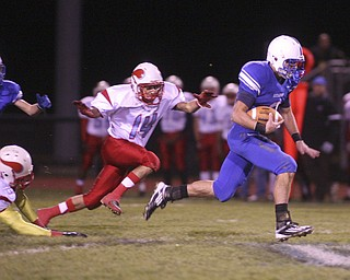 ROBERT  K.  YOSAY  | THE VINDICATOR --..Big run for Blue Devils #2 Donnie Bolton as he ran for  a first down and then some as he made it down to almost scoring - Behind him is #14 Mato Vunak for the Vikings..Regional quarter final at Western Reserve Stadium - Western Reserve Blue Devils  VS   Villa Angela St Joesph Vikings.--30-..(AP Photo/The Vindicator, Robert K. Yosay)