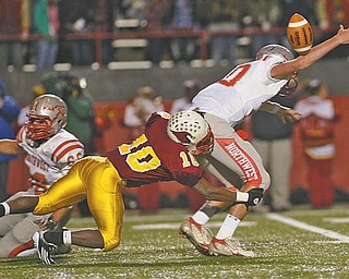 Cardinal Mooney's Justus Ellis-Moore (10) takes down Northwest quarterback Nick Riley, causing a fumble, during last Friday's Division III playoff game at Stambaugh Stadium. The Cardinals play Steubenville in a regional semifi nal on Friday night.