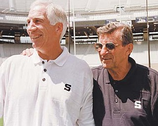 Penn State head football coach Joe Paterno, right, poses with his defensive coordinator Jerry Sandusky during Penn State Media Day at State College, Pa. Sandusky, 67, was arrested Saturday on charges that he sexually abused eight boys.