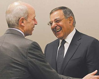 Secretary of Defense Leon Panetta, right, chats with Jonathan Tisch, chairman and CEO of Loews, during a meeting for CEOs and others hosted by the Goldman Sachs Foundation in New York on Monday. Ahead of Veterans Day, the Senate voted to start debate on tax credits for businesses to hire unemployed veterans or injured veterans who have been out of work.
