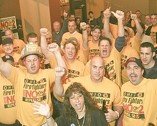 ROBERT K. YOSAY | THE VINDICATOR..Firefighters and policeman and many supporters of defeating issue 2 celebrate at V2 in Downtown Youngstown ..-30