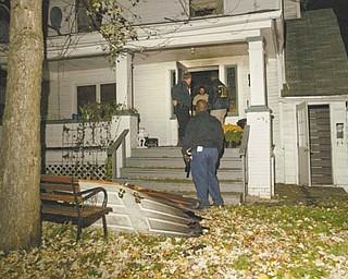 Youngstown Fire Department and State Fire Marshal personnel investigate the scene of a fatal fire at 3144 Pine Hollow Drive in Youngstown on Monday night. Firefighters responded to a call at 6:55 p.m. and pulled a man from the house who later died. The man was identified as Andrew Douglas Jr., 45, who lived at the address.