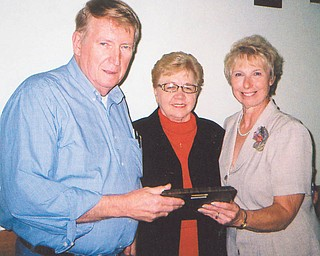 Alumni honor the Hecks: The Springfield Local Alumni Association bestowed its Appreciation Award to Ed and Shirley Heck, above, left, at the annual dinner Sept. 25. Both were involved with 4-H leadership. He served eight years on the Springfield Local Board of Education, and she was the first elected female trustee for Springfield Township. Her leadership included spearheading the projects of water and sewer services to Petersburg and directing the 2003 township bicentennial celebrations. Her efforts as trustee included strong support for the education of township children. Alumni president Zonda Haase, right, presents the plaque.