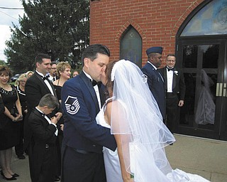 Sgt. Bob Barko Jr., who is Superintendent of Public Affairs at Youngstown Air Reserve Base in Vienna, has been in the military for more than 10 years. He married Deana Creatura in October. Honoring her brother and his new wife is Kerry Geraci of Boardman, who sent in the photo.
