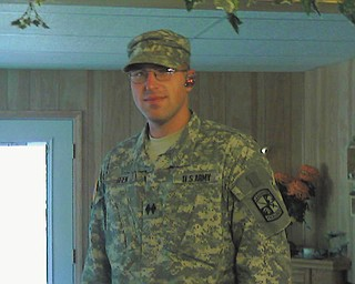 This photo submitted by Dee Deem of Struthers shows her son, Lt. Michael Deem, who has served in the U.S. Army since 2001. He is stationed in Germany with his wife, Sara, and daughters Alex, Abby and Isabella.